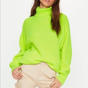 Neon green turtleneck sweater.